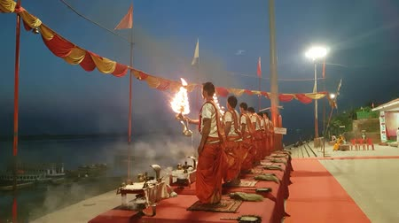 puja : Priests Performing A Morning Puja In Varanasi