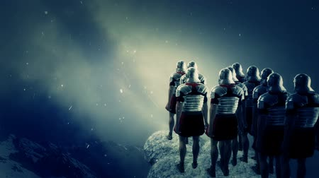 legionary : Imperial Roman Soldiers Looking at a Battlefield Under Snow Stock Footage