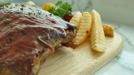 ribs : Grilled BBQ pork rib steak with sauce