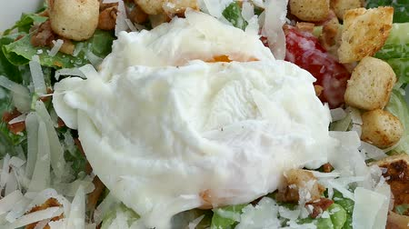 poached egg : Caesar salad with soft boiled egg