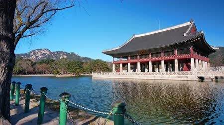 gyeongbokgung : SEOUL, SOUTH KOREA - DECEMBER 4, 2018 : Time lapse of Gyeongbokgung palace and traffic in Seoul South korea.