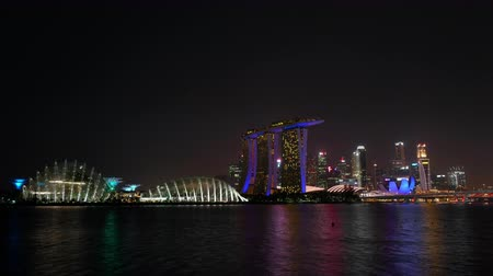 szingapúr : Beautiful Time lapse Singapore city skyline and view of Marina Bay Sands Stock mozgókép