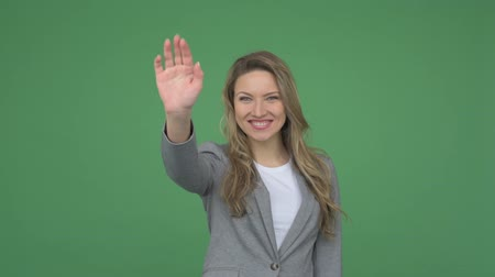 olá : Corporate lady waving hi to her colleague Stock Footage