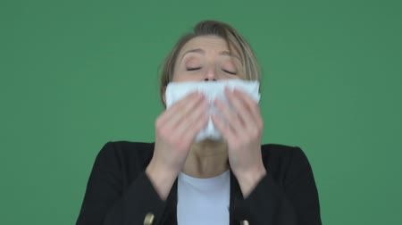 alerji : Sick woman sneezing in a tissue Stok Video