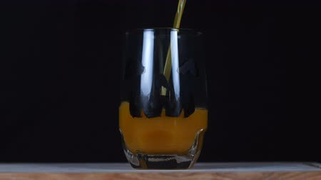 темный фон : Halloween. Juice is poured into a glass.