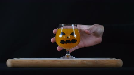 самодельный : Helloween. Levitating hand taking the glass. Стоковые видеозаписи