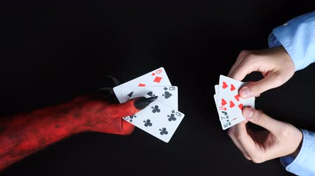 fraudulent : Businessman playing card with the devil.