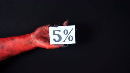 drápy : Red demon hand holding sale card. 5%