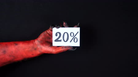 drápy : Red demon hand holding sale card. 20%