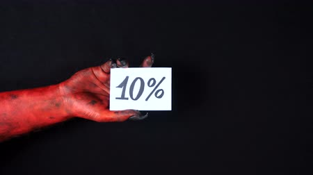 drápy : Red demon hand holding sale card. 10%