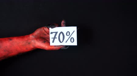 drápy : Red demon hand holding sale card. 70%
