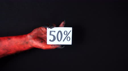 drápy : Red demon hand holding sale card. 50%