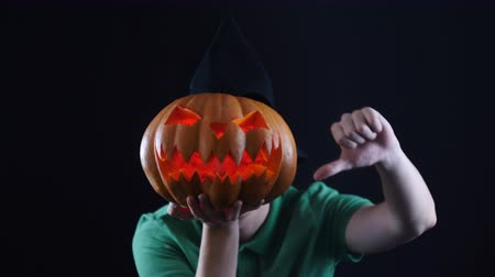 отказ : Halloween. Pumpkin head showing dislike sign.