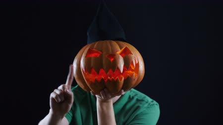 refusing : Halloween. Pumpkin head showing not allowing gesture.