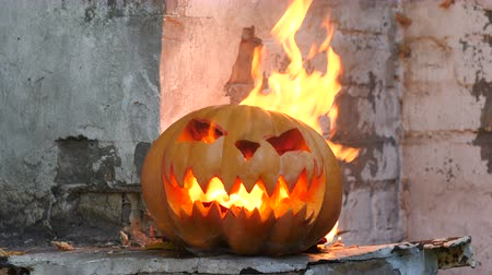 frightful : Halloween. Burning pumpkin. Medium shot