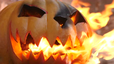 frightful : Halloween. Burning pumpkin. Side view.