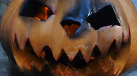 frightful : Halloween. Burning charred pumpkin. Close-up view
