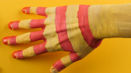 feloszt : Catalan hand leaves a trace on a yellow background