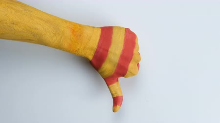 feloszt : Catalan hand showing dislike sign.