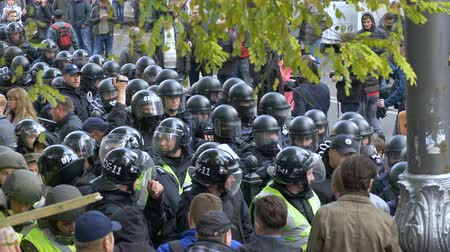 cruelty : KYIV, UKRAINE - OCT 17, 2017: Detachment of policemen in helmets is preparing to disperse the crowd.