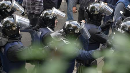 плохо : KYIV, UKRAINE - OCT 17, 2017: Detachment of policemen in helmets moving one after another along the street.