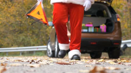costumes : Santa Claus set an emergency stop sign on road 50 fps