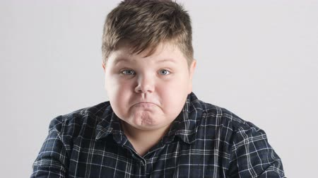 spite : Young fat boy shows anger, aggression and hatred