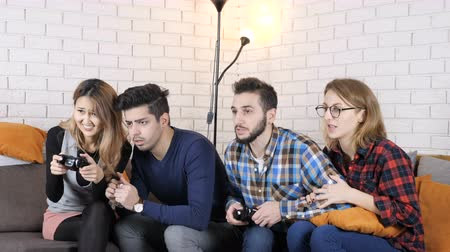 юмористический : Multinational company sit on the couch, boys playing versus girls 50 fps