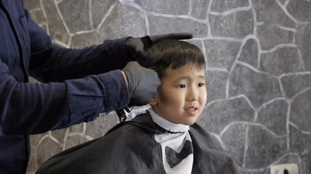 professionally : Barber shaves Asian child whiskey 60 fps
