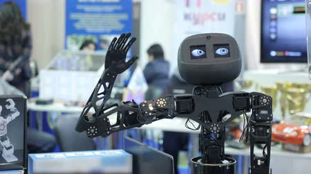 yours : Funny cute robot waving his hand, greeting gesture. Stock Footage