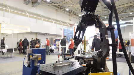 fire arms : KYIV, UKRAINE - OCTOBER 21, 2017 Robotic welding arm, demonstration mode.