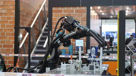hidrolik : KYIV, UKRAINE - OCTOBER 21, 2017 Robotic welding arm, demonstration mode