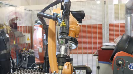 hydraulic : KYIV, UKRAINE - OCTOBER 21, 2017 Robotic welding arm, demonstration mode. Nanotechnology