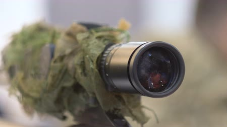 destroyer : The optical sight of a sniper rifle, optics, weapons, close up 60 fps