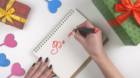 iyi olmak : Valentines Day, illustration, womans hand writes in a notebook, Be my Valentine 60 fps