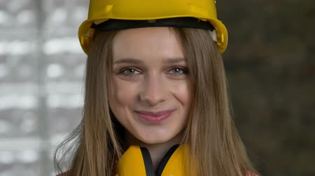 truly : Young attractive girl builder is smiling, gigling, sinceruty, emotion concept.