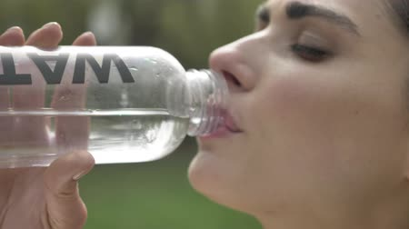self motivated : Young confident girl sportsman drinks water outside, healthy lifestyle, sport conception