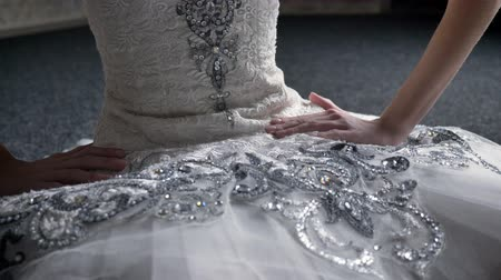 femininity : Girl ballerina touches tutu, sitting on floor, preparation for dance, ballet concept Stock Footage