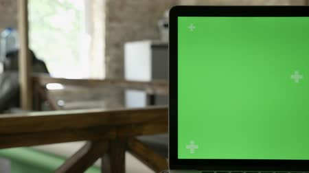 blank : Close moving shot of laptops screen with chromakey in modern office Stock Footage