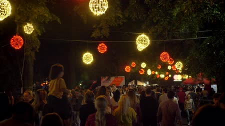 közönség : Footage of crowd walking during festival at night Stock mozgókép