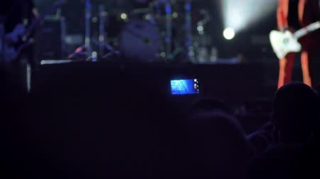 película de filme : People in crowd recording video at rock concert