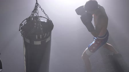 üstsüz : Shirtless kickboxer boxing punching bag as exercise, topshot, training for big fight Stok Video