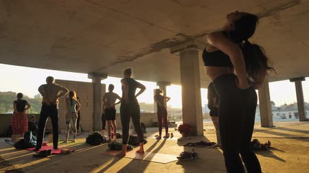 meditující : People yogis are doing yoga exircises in abandoned building in summer on sunrise, healthy lifestyle, movement concept, sport concept, relax concept