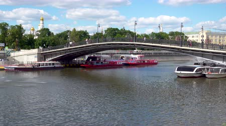 bridge man made structure : Moscow, Russia - June 26, 2017 Tourist boats under Luzhkov Bridge