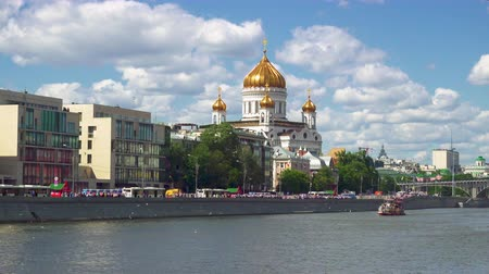 bridge man made structure : Moscow, Russia - June 28, 2017: Tourist ship on the Moscow river. Cathedral of Christ the Saviour.