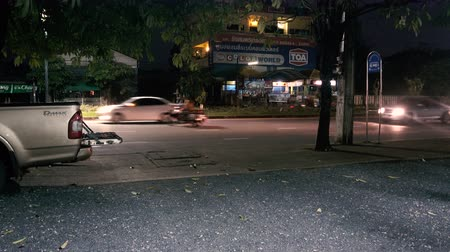 surat : Surat Thani, THAILAND - December 20, 2017: night traffic on the road in the city of Surat Thani,Thailand