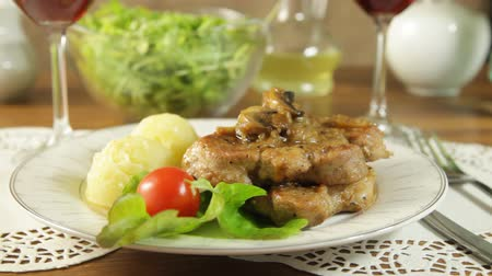 schabowy : Fried pork chop with mushrooms and potatoes