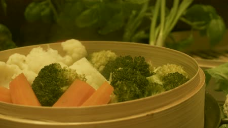bamboo steamer : Mix vegetables steaming in bamboo steamer. Includes cauliflower, broccoli and carrot