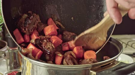 Cooking irish stew, inside a metal pot. Traditional St. Patricks day dish