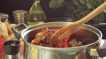 cordeiro : Cooking irish stew, inside a metal pot. Traditional St. Patricks day dish